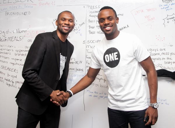 ONE's Media Manager Nde congratulates Melvin during a visit to ONE's Johannesburg office.  Photo: ONE
